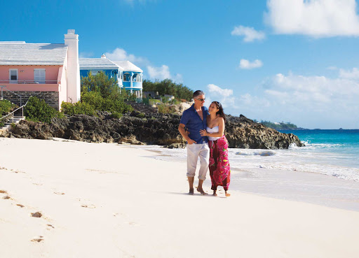 beach-couple-Bermuda - Stroll along some of the beautiful beaches of Bermuda. Bermuda sits far north of the Caribbean Sea off the coast of North Carolina, but the archipelago of 120 islands and islets has a Caribbean soul.