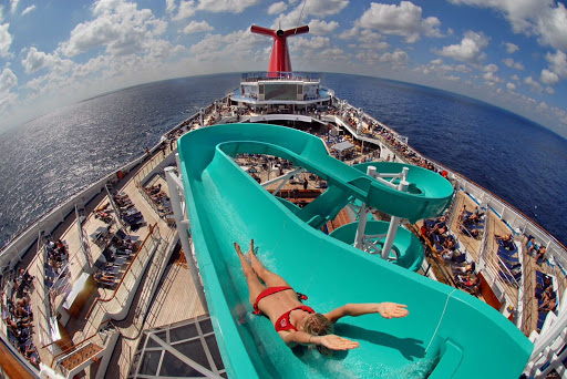 Carnival-Freedom-Lido-deck- - Freedom to slide: A girl takes off from the top of the wickedly fun slide on the Lido deck of Carnival Freedom.