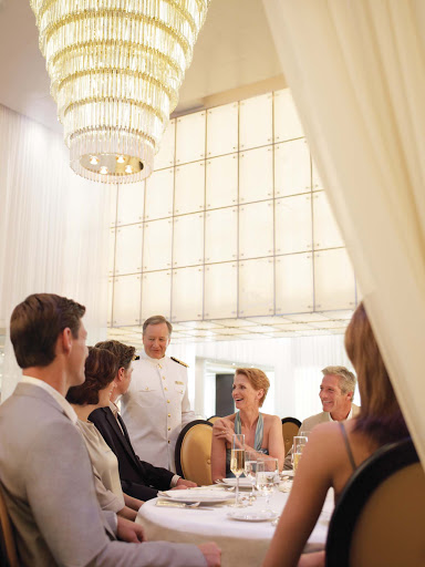 Captain_and_Guests_The_Restaurant_Seabourn - Enjoy delectable food, chat with the captain of your Seabourn ship and take in the fine dining ambiance of The Restaurant, which is open for breakfast, lunch or dinner.
