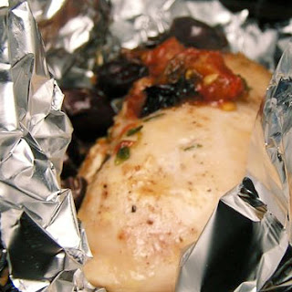 Chicken Breasts in Foil with Tomato, Olives, and Parmesan