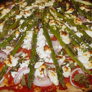 Whole Wheat Pizza with Sundried Tomato Puree, Red Onions, Asparagus, and Goat Cheese.