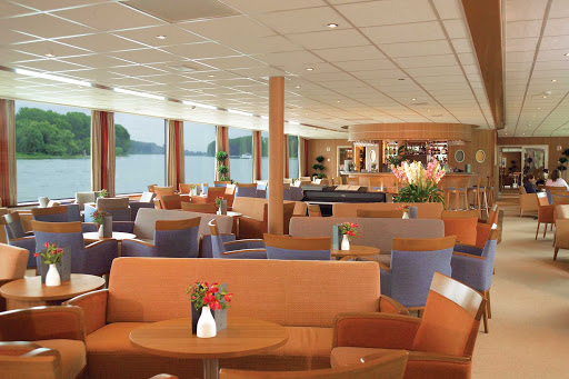 Viking-Helvetia-Lounge - Enjoy the company of friends and take in views of the Rhine River in the comfortable surroundings of the lounge aboard Viking Helvetia.