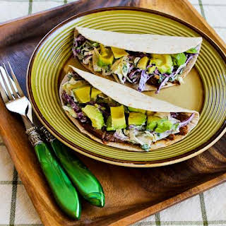 Slow Cooker Shredded Beef Tacos with Spicy Slaw and Avocado.
