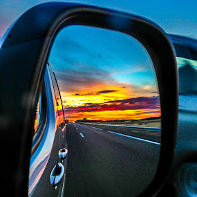 Spanish Highway Sunset by Justin Murazzo - Landscapes Sunsets & Sunrises ( car, europe, espana, highway, burgos, street, iberian peninsula, beauty, travel, road, yellow, sun, spain, astorga, mirror, castile, plateau, drive, leon, grey, clouds, castile and leon, orange, dry, purple, speed, beautiful, scenic, pass, osorno, cyan, red, iberia, blue, sunset, violet, scenery, fast, freeway, passing,  )