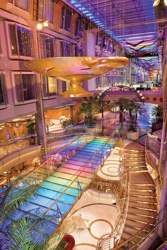 Independence-of-the-Seas-Royal-Promenade - A distant view of some of the shops, cafes and lounges on Royal Promenade, the heart of Independence of the Seas.