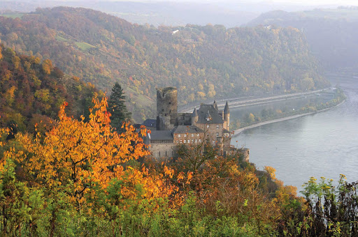 Katz Castle, above the town of St. Goarshausen, Germany, in autumn. The castle was built around 1371 and is now privately owned.