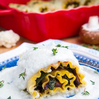 Mushroom Lasagna Roll Ups in Creamy Gorgonzola Cauliflower Sauce.
