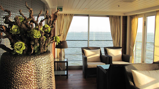 AmaDante-Aft-Lounge - Experience a stunning sunset from the light-filled lounge as you sail Europe's waterways aboard AmaDante.