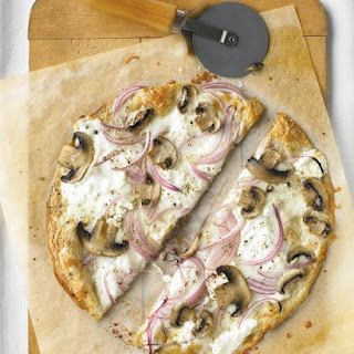 Thinnest Crust Pizza with Ricotta and Mushrooms.