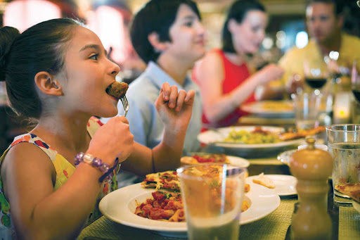 Norwegian-Cruise-Line-dining-LaCucina-girl - Enjoy authentic Italian dishes that the kids will like, too, at La Cucina during your Norwegian Cruise Line sailing.