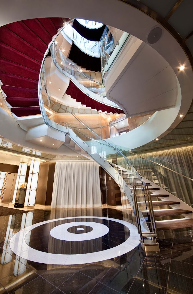 The Atrium staircase showcases the style and elegance you'll find aboard Seabourn Sojourn.