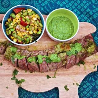 Cilantro Pesto-Stuffed Pork Tenderloin With Summer Succotash.