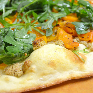 Roasted Butternut Pizza With Arugula And Walnut-garlic Pesto.