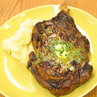 Dry-Aged Rib-Eye Steaks with Emeril's Maitre D'Hotel Butter.