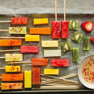 Fresh Fruit Sticks With Lime And Chili Syrup.