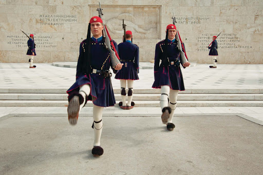 Travel to the Syntagma Square in Athens, Greece, via Seabourn and watch the Changing of the Guard featuring the Evzones in full costume.
