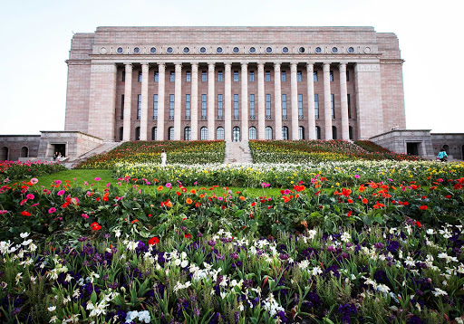 The massive stairs in front of the colossal Finnish parliament house were surrounded by 60,000 flowers for one week as an installation by artist Kaisa Salmi.