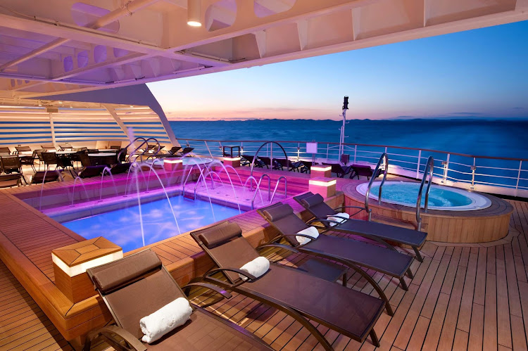 Relax and enjoy the colorful, peaceful indoor pool on the aft deck of Seabourn Odyssey. It's one of five swimming areas on the ship.