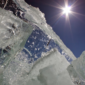 Looking up! by Jamie Rabold - Nature Up Close Other Natural Objects ( canon camera, winter, stacked ice, cold, ice, lake superior, 50d, sun, up )