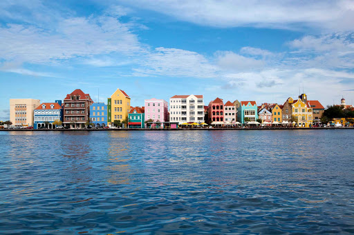 Curacao-Handelskade-view - A view of the Handelskade area, a picturesque stretch of brightly painted Colonial Dutch buildings in Willemstad, Curacao.