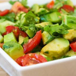Vegan Tomato Salad with Cucumber, Avocado, Cilantro, and Lime.