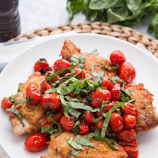 Pan-Seared Crispy Chicken Thighs with Blistered Tomatoes and Basil