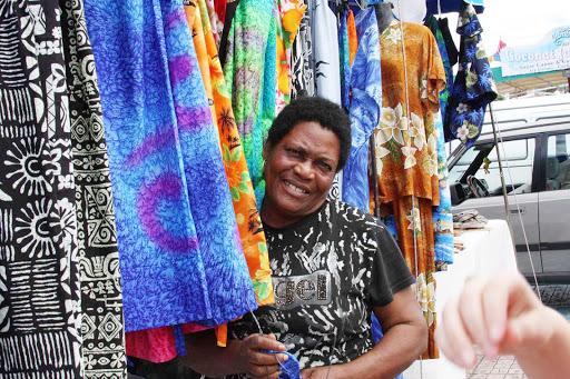 market-vendor-St-Maarten - Selling textiles in St. Maarten in the Caribbean.
