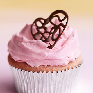Raspberry Cupcakes with Pink Buttercream and Lacy Chocolate Hearts.