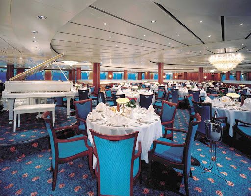 Norwegian-Sky-dining-Crossings-dining-room - The posh ambience, impressive views and wonderful meals of Norwegian Sky's Crossings dining room will make any guest feel special.