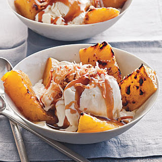 Broiled Pineapple with Bourbon Caramel over Vanilla Ice Cream.