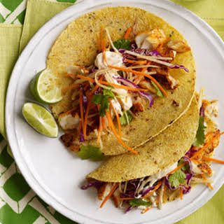 Fish Tacos with Cabbage-Carrot Slaw and Spicy Crema.