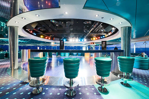 MSC-Lirica-Blue-Club-Disco - With its blue-green palette and wrap-around windows, MSC Lirica's Blue Club Disco is a captivating place to dance the night away.