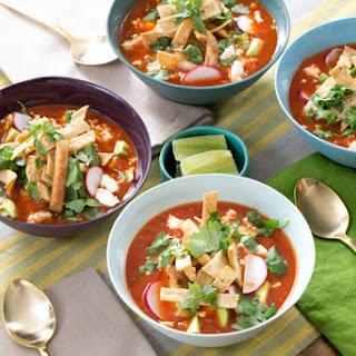 Vegetable Tortilla Soup with Hominy, Avocado & Queso Fresco.