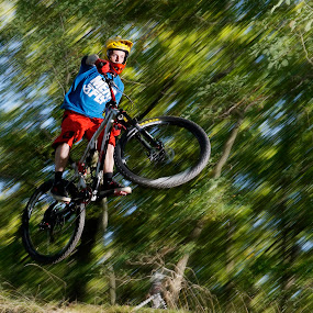 Mountain bike jump by Naďa Murmakova - People Portraits of Men ( mountain, downhill, cycling, acceleration, recreation, stunt, race, bicycle, explode, danger, sky, biker, trail, lifestyle, action, motion, dirt, trick, hill, cycle, fun, jump, fly, mtb, biking, outdoors, racer, air, fast, conceptual, excitement, wheel, bicycling, explosive, road, risk, adventure, bike, riding, racing, athlete, cyclist, extreme, speed, sport, competitive, descend, swift, competition,  )