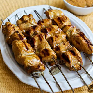 Grilled Curried Chicken Skewers with Spicy Peanut Sauce.