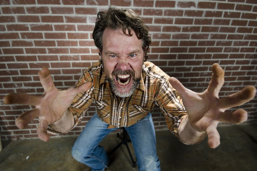Angry Man by Chris Higgins - People Portraits of Men ( wideangle, jeans, angry, beard, man )