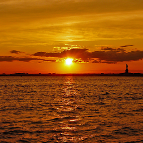 FIVE SECONDS OF SUMMER by Kendall Eutemey - Landscapes Sunsets & Sunrises ( statute of liberty, orange, kendall eutemey, waterscape, sunset,  )