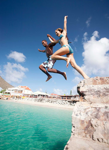 jump-rocks-St-Maarten - Visitors jumping from rocks to the sea in St. Maarten.