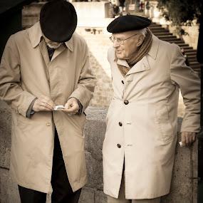 Two elderly French gentlemen deep in discussion. by Stefen Dicks - People Street & Candids ( gentlemen, paris, old, conversation., resistance, war )