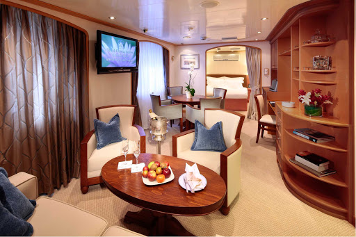 Admiral-Suite-SeaDream - At 375 square feet, the Admiral Suite on a SeaDream ship comes with a separate living and dining area, master bedroom, 1.5 baths and three panoramic windows.