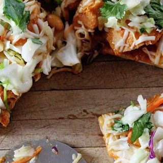 Indian Butter Chicken Naan Pizza with Lime & Peanut Slaw.