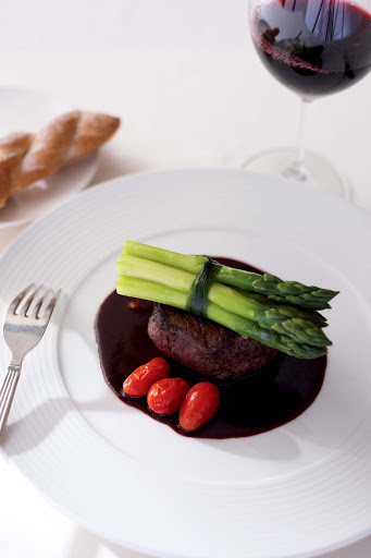 Culinary-Experiences-Steak-Dinner-Entree - Steak is paired with tomatoes and asparagus for a main entrée aboard Crystal Symphony.