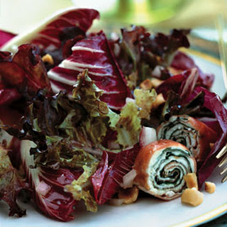 Bronze and Red Lettuce Salad with Serrano Ham and Goat Cheese Spirals.