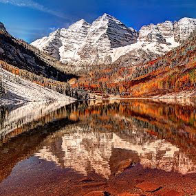 Maroon Bells Lake by John Larson - Landscapes Mountains & Hills ( water, mountains, blue sky, snow, fall, reflections, lake, rocks,  )
