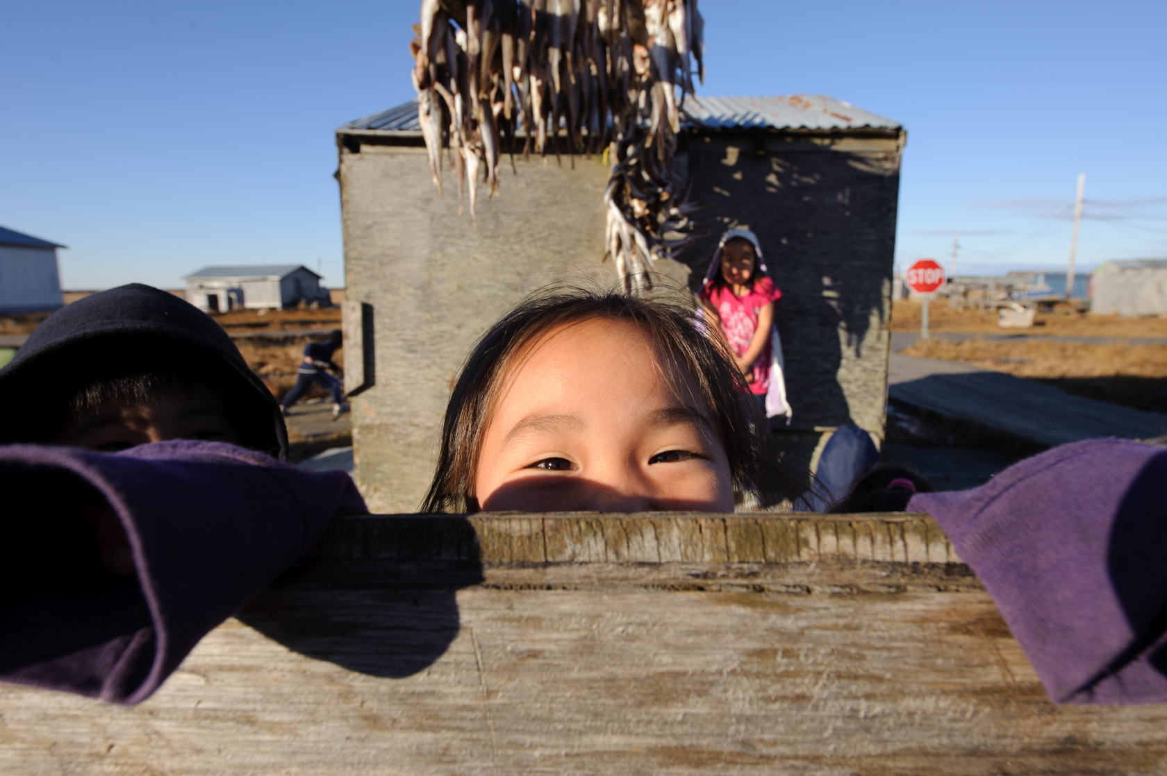 Drying fish and kids, Kongiganak, Alaska