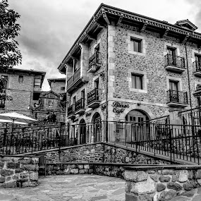 Potes Cafe by Justin Murazzo - Black & White Buildings & Architecture ( mountain, relax, travel, house, historic, spain, city, sky, tree, lifestyle, dark, light, black, flower, grass, flat, white, tourism, northern, roof, iberia peak, tourist, cantabria, day, green coast, outside, sidewalk, home, europe, espana, shrub, beauty, road, north, breathtaking, coast, modern, tranquil, overlook, asturias, manmade, bricks, grey, balcony, picos, building, vertical lines, afternoon, beautiful, scenic, gray, urban, pwc, potes, fog, basket, cloud, scenery, historical, europa, stones, daylight, peaks, mist,  )
