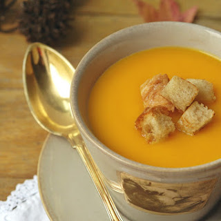 Pumpkin and Carrot Cream Soup with Sourdough Bread Croutons.