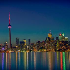 Toronto Skyline by Toronto-Images .Com - City,  Street & Park  Skylines ( reflection, skyline, spectacular, harbor, metropolis, toronto, metropolitan, reflections, travel, architecture, cityscape, toronto building, urbanization, city, center, lights, modern, sky, skyscraper, buildings, cn tower, tall, downtown, harbor front, water, highrise, building, harbourfront, toronto waterfront, canada, toronto tower, blue hour, ontario, lake, scenic, landmark, urban, tower, blue, toronto cityscape, canadian, night, toronto skyline, scenery, view, downtown toronto, toronto city, waterfront )