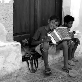 The kid with the accordion by Nikos Pilpilidis - Black & White Street & Candid ( accordion, white, puppy, kids, black )