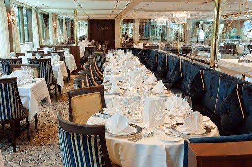 Compass Rose, the main dining room on Tauck's sister river cruise ships Inspire and Savor, boasts panoramic windows and a full menu service for dinner.